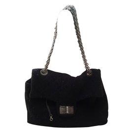 2.55 en tweed noir taille XL. - Chanel