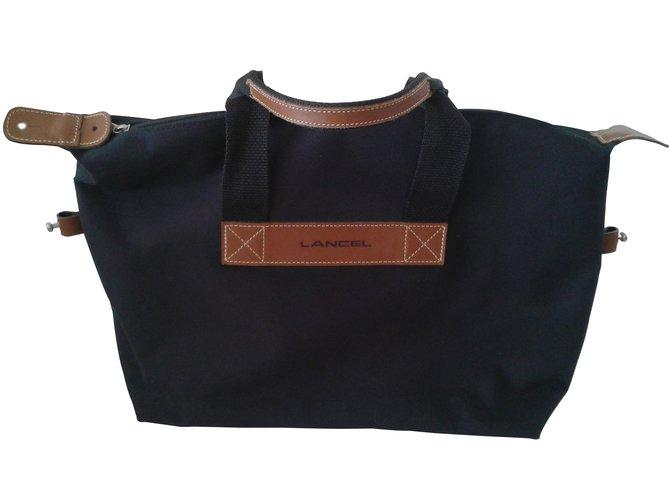 sacs de voyage lancel sacs de voyage toile noir joli closet. Black Bedroom Furniture Sets. Home Design Ideas
