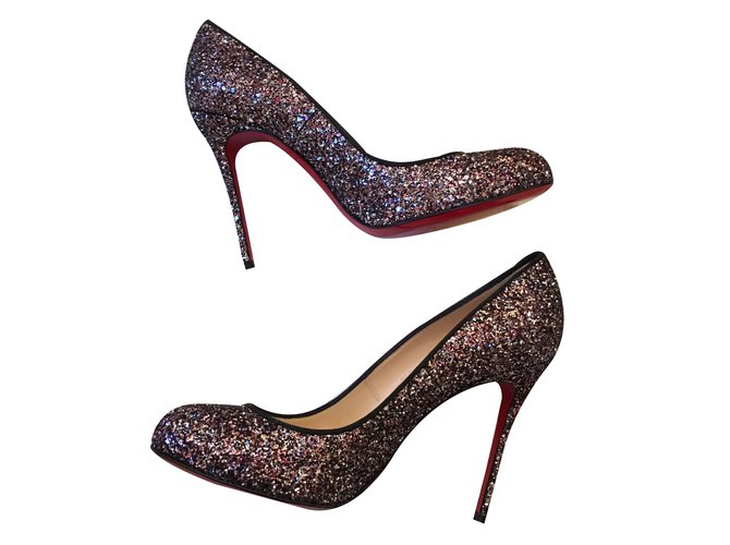 new product 6639f bbc41 Christian Louboutin Purple Glitter Stiletto Heels