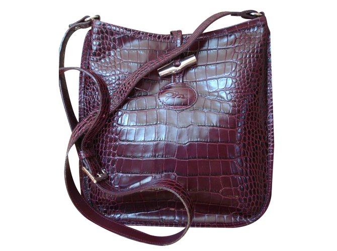 2a2ad80fd1 Longchamp Handbags Handbags Leather Dark red ref.18831 - Joli Closet