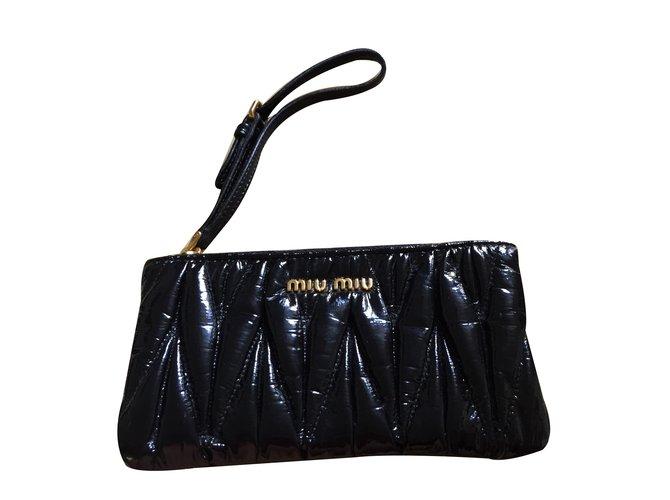 784877e248f Miu Miu Clutch bag Clutch bags Patent leather Black ref.27820 - Joli ...