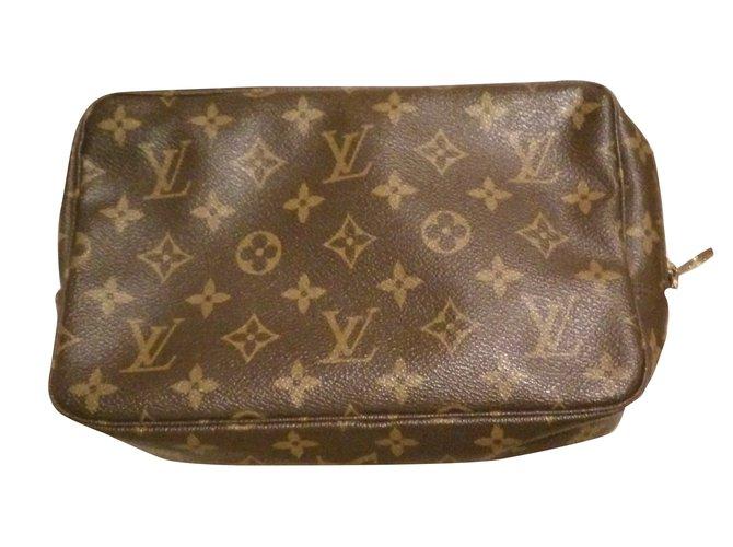 e7a8228a7701 Louis Vuitton Trousse 23 Clutch bags Cloth Brown ref.29048 - Joli Closet