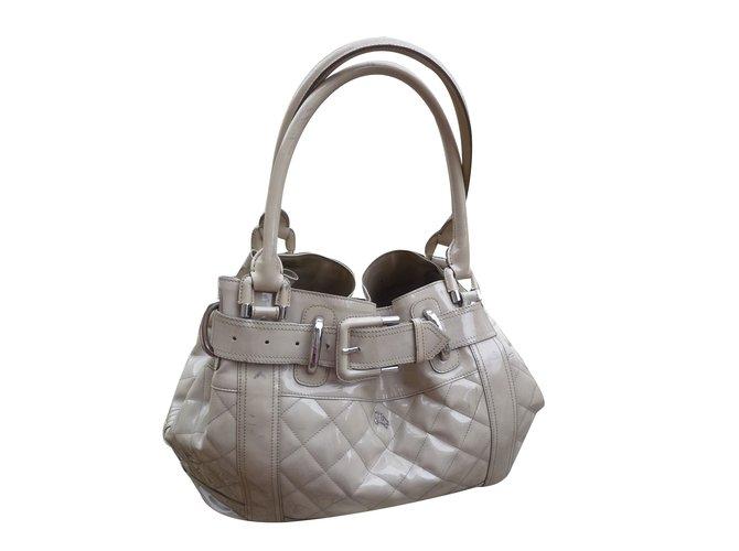 b3f91cdc538a Burberry Beaton model Handbags Patent leather Cream ref.33681 - Joli ...