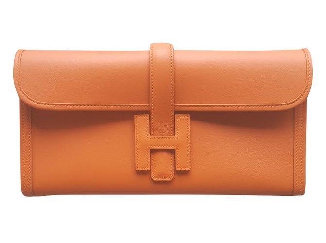 Sacs à main Hermès POCHETTE HERMES JIGE ELAN Cuir Orange ref.36108