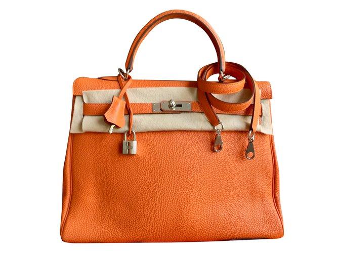 87f31c7302 Sacs à main Hermès Magnifique sac HERMES Kelly 35 cm cuir Togo orange  bijouterie Palladium Cuir