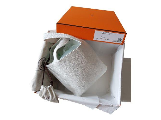 Sacs à main Hermès PICOTIN LOCK 22 TAURILLON CLEMENCE BLANC Cuir Blanc ref.44214