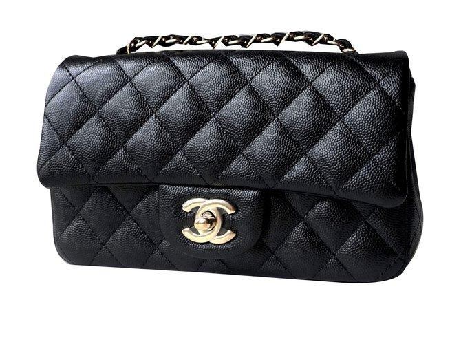 4f8928a84a1407 Chanel Mini Handbags Leather Black ref.46018 - Joli Closet