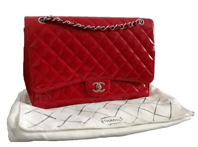 3949cb7a0b79 Chanel, Handbag. 2,500€. Add to my wishlist. Maxi jumbo timeless classic bag  in patent red leather ...