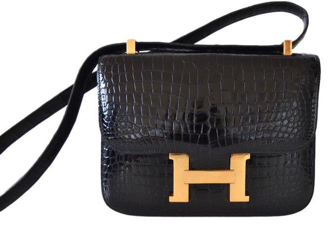 Sacs à main Hermès CONSTANCE crocodile noir Cuirs exotiques Noir ref.47373