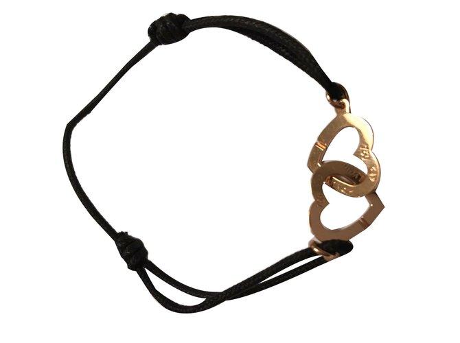 ef7b49fcfe5 Bracelets Dinh Van Superbe bracelet double coeur Dinh Van en or rose! Or  rose Noir