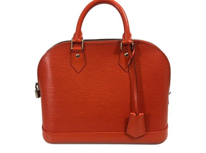 Sacs à main Louis Vuitton Alma PM Cuir Orange ref.54197