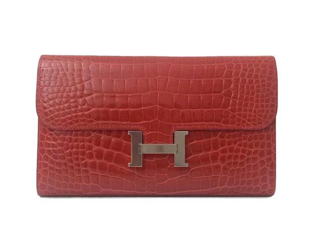 Pochettes Hermès Sublime Pochette Hermès Constance en alligator couleur géranium neuf ! Cuirs exotiques Rouge ref.54856