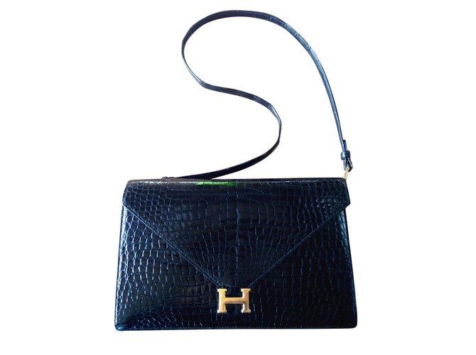 b106aa2d81b0 Hermès Lydie Handbags Exotic leather Black ref.55387 - Joli Closet