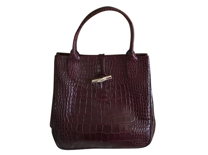 84f20167e6 Longchamp Handbags Handbags Leather Dark red ref.55424 - Joli Closet
