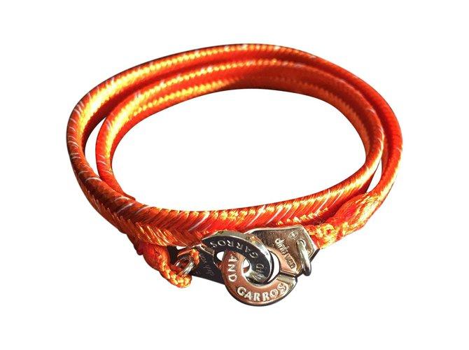 7f054c87434 Bracelets Dinh Van Braclet Dinh Van menottes Roland Garros Argent Orange  ref.57692