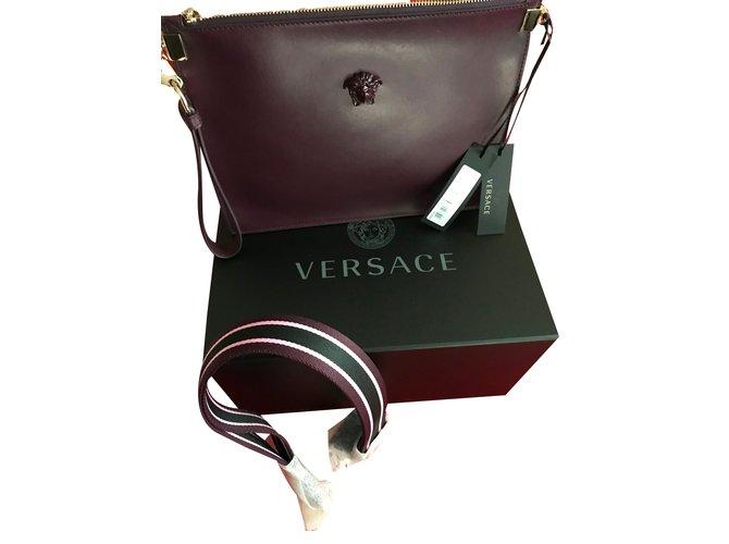 Gianni Versace VERSACE MEDUSA CALF LEATHER POUCH - burgungy All new  Handbags Leather Dark brown ref 8c3c441ac5927
