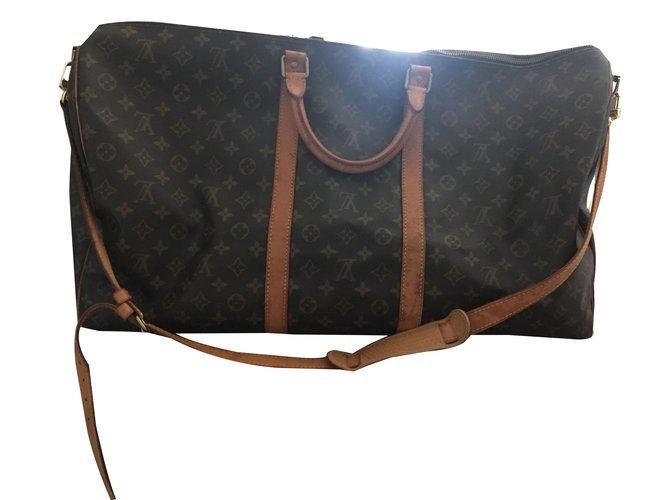 Sacs de voyage Louis Vuitton KEEPALL BANDOULIÈRE 60 Cuir Marron foncé ref.65110
