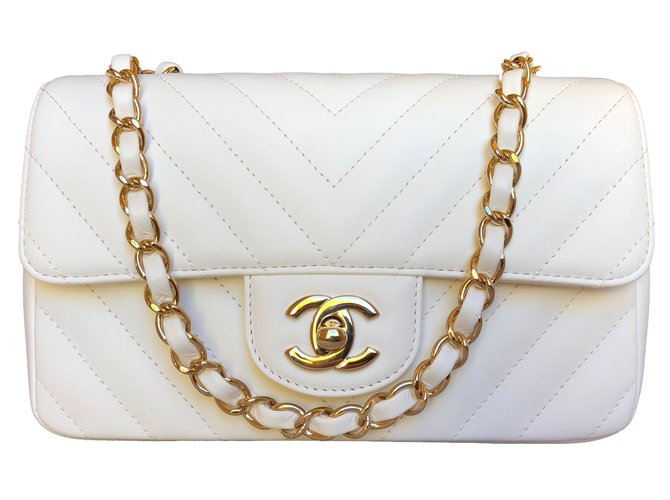 9bf7e7448377 Chanel, Mini Flap Ivory Lambskin with Shiny Light Gold Chain. $3,992. Add  to my wishlist. Brand New ...