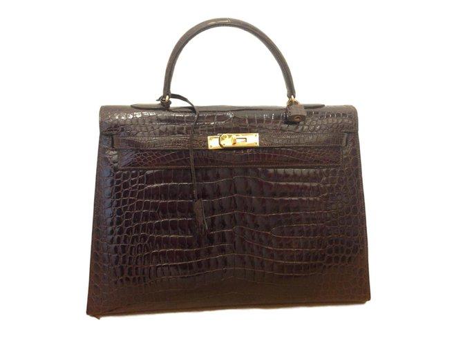 Hermès Kelly 35 Handbags Exotic leather Brown ref.71107