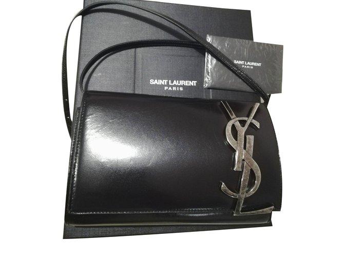e2fd0586e2 Yves Saint Laurent Clutch bags Clutch bags Leather Black ref.76518 ...