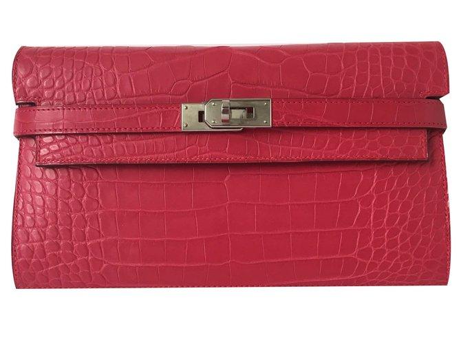 Portefeuilles Hermès Hermes portefeuille kelly wallet Cuirs exotiques Rose ref.79331