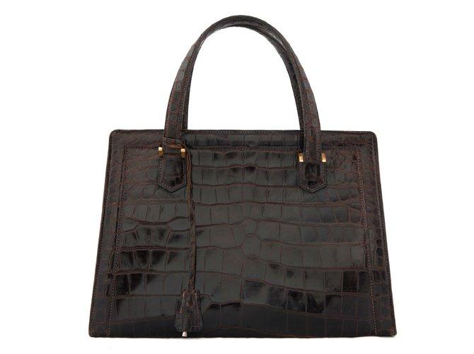 Sacs à main Hermès Sac ''Pullman'' en crocodile brun Cuirs exotiques Marron ref.81503