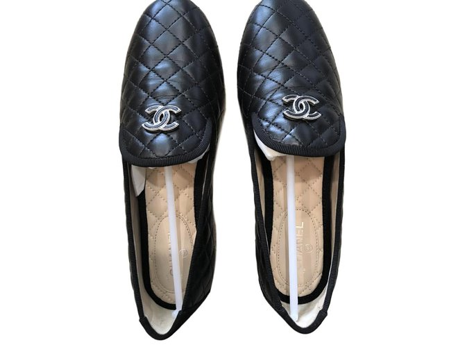 Chanel black quilted loafers Flats