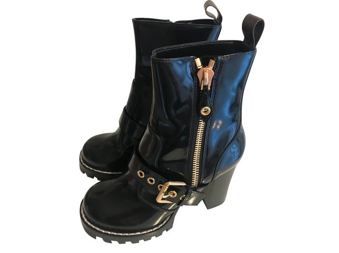 516408282ade Louis Vuitton Star trail ankle boot Boots Leather Black ref.88372 ...