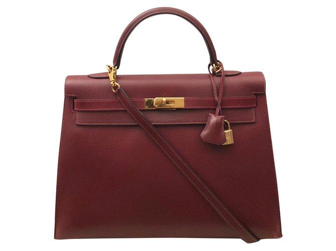 Sacs à main Hermès Sac Hermes Kelly 35 Sienne Cuir Bordeaux ref.92287