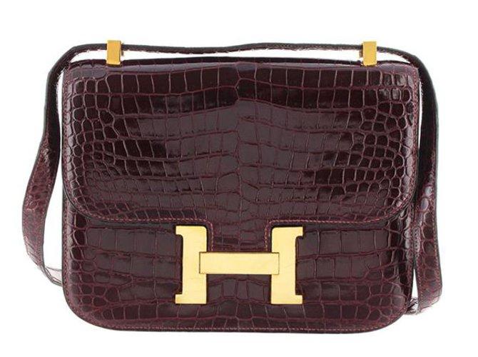 Sacs à main Hermès Constance En Cuir De Crocodile 23 Cuir,Autre Rouge,Bordeaux ref.98260