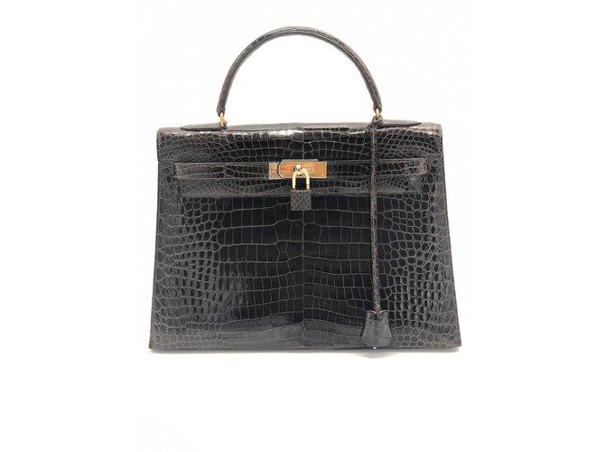 Sacs à main Hermès kelly 32 crocodile ébène très bon état Cuirs exotiques Ébène ref.98830