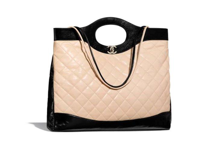 Sacs à main Chanel Grand cabas CHANEL 31 Cuir Noir,Beige ref.102441 ... 3f7ef0d4ef04