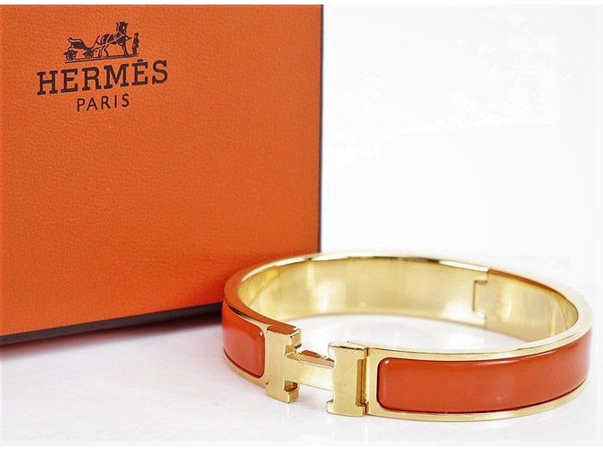 6c4f160d656d Hermès Hermès Click Clack H Gold Plated Bracelet and Orange Enamel Bracelets  Gold-plated Orange