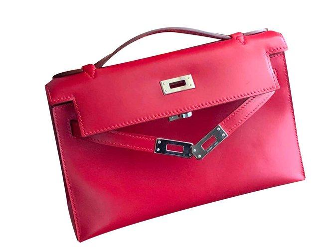 Pochettes Hermès Pochette Kelly Hermès Cuir Rouge ref.106674