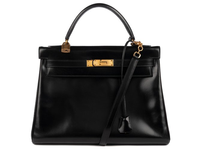 Hermès hermes kelly 32 returned in black box leather with shoulder strap, in excellent condition! Handbags Leather Black ref.121025