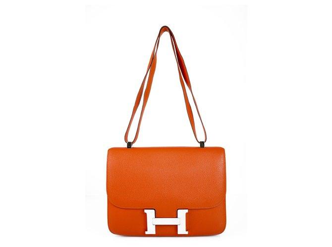 Sacs à main Hermès HERMES Constance Cartable 29 Quincaillerie en cuir palladium orange Chevre Mysore Cuir Orange ref.123453