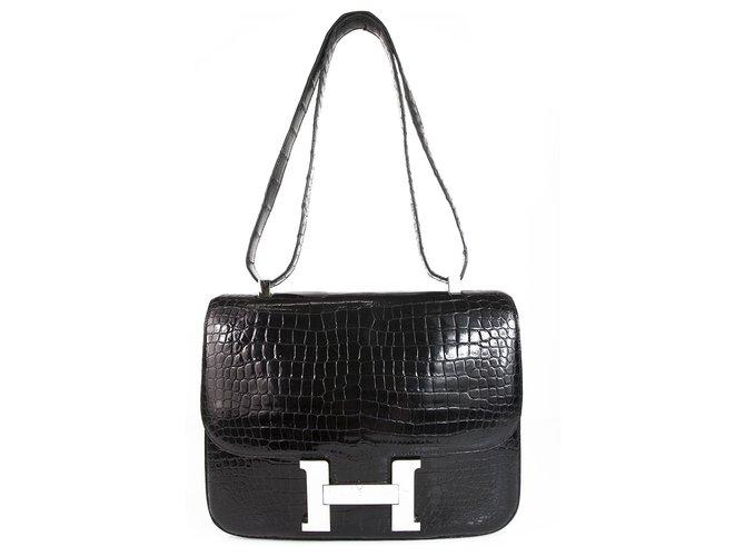 Sacs à main Hermès HERMES Constance Cartable 29 Quincaillerie Porosus Palladium en Crocodile Noir Brillant Cuirs exotiques Noir ref.123454