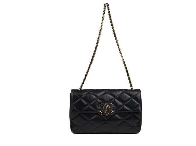 5b75b3807094f7 Chanel Classic vintage Chanel bag in navy quilted lambskin! Handbags  Lambskin Navy blue ref.