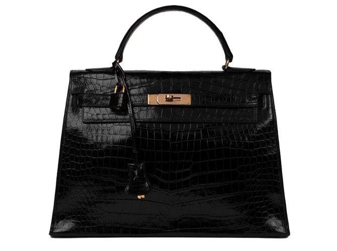 Sacs à main Hermès Superbe Hermès Kelly 32 sellier en Crocodile Porosus noir, bijouterie plaquée or, en très bon état général ! Cuirs exotiques Noir ref.125518