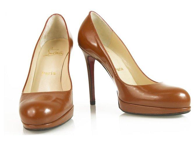 3c06a4f6dc3 Christian Louboutin Classic Brown leather round toe platform pumps sz 37