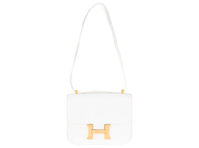 Sacs à main Hermès Superbe Hermès Constance en cuir de veau grainé blanc, accastillage doré  en très bon état! Cuir Blanc ref.126550