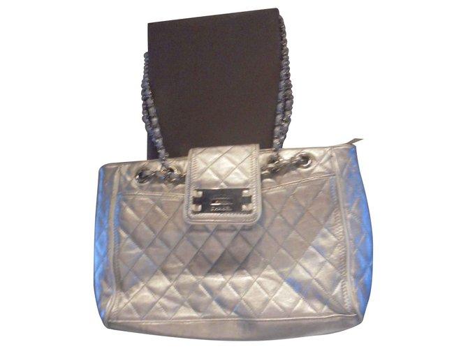 Sacs à main Chanel Authentique sac Chanel Reissere  model cabas East West Collector shopping XL N° serie 1050 1945 Cuir Argenté ref.129766
