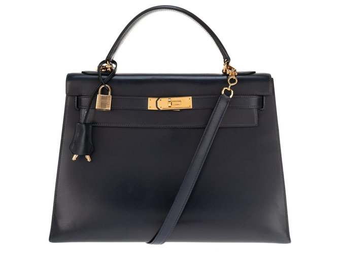 Hermès hermes kelly 32 saddle with shoulder strap navy blue, Golden Jewelery, In very good shape ! Handbags Leather Navy blue ref.133330