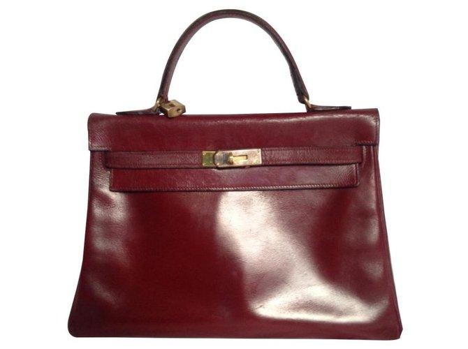 Hermès Kelly 32 Handbags Leather Dark red ref.136193