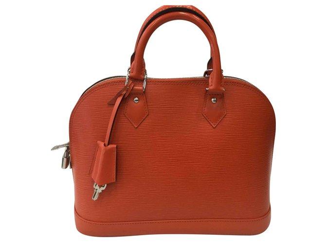 Sacs à main Louis Vuitton ALMA Cuir Orange ref.142474