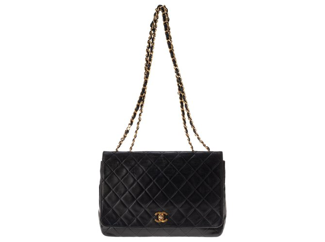 Chanel Classic Chanel handbag in navy quilted lambskin, golden hardware! Handbags Lambskin Navy blue ref.149590