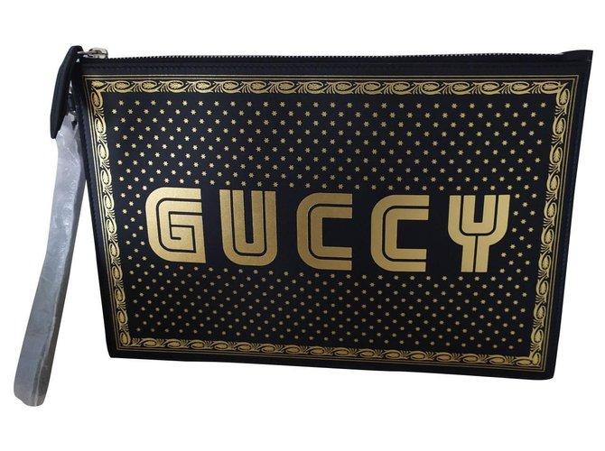 Pochettes Gucci Pochette Gucci GUCCY Cuir Noir,Doré ref.156249