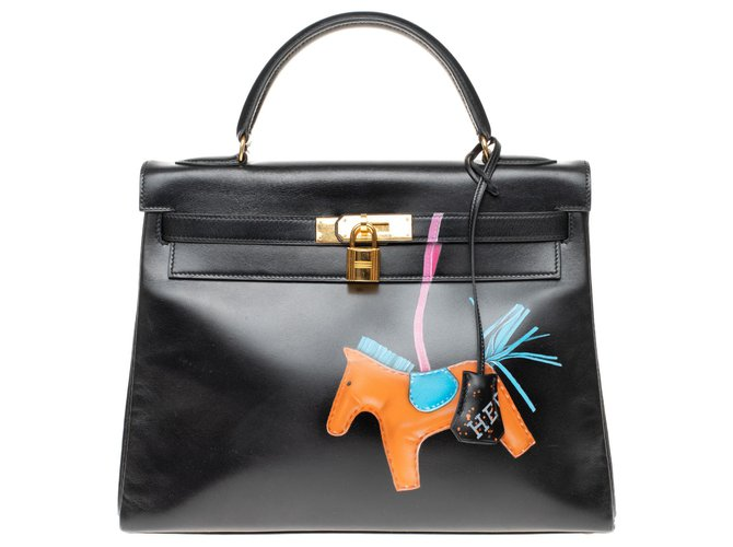 """Hermès Creation by trompe l'oeil by Kelly PatBo 32 """"Rodeo"""" in black box leather and gold-plated hardware Handbags Leather Black ref.156741"""