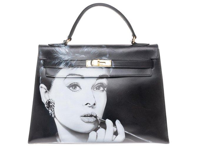 "Hermès hermes kelly 32 saddle in black box ""Audrey Hepburn"" customized by the artist PatBo! Handbags Leather Black ref.158144"