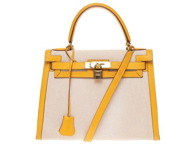 Sacs à main Hermès Hermès Kelly 28 sellier bandoulière bi-matière en toile et cuir courchevel jaune, garniture en métal doré Cuir,Toile Beige ref.158514